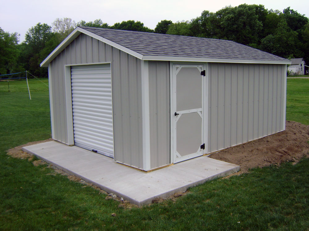 Atlantic shed with metal siding, roll top door and swinging barn door.