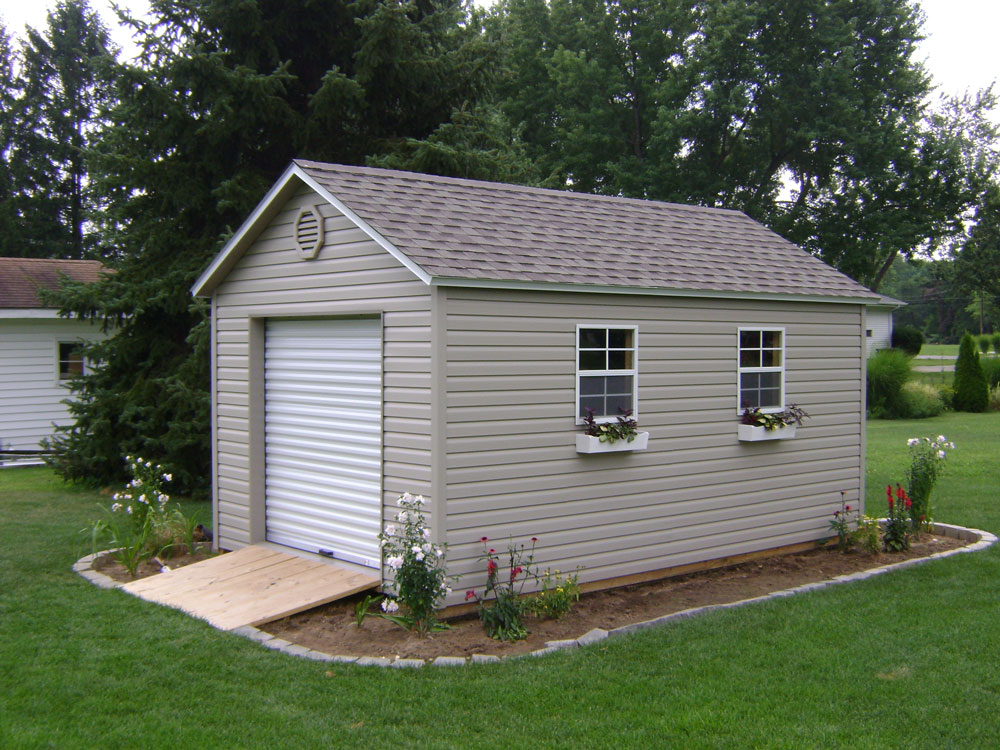 Atlantic Storage Shed. Vinyl siding mini barn with roll top door and windows