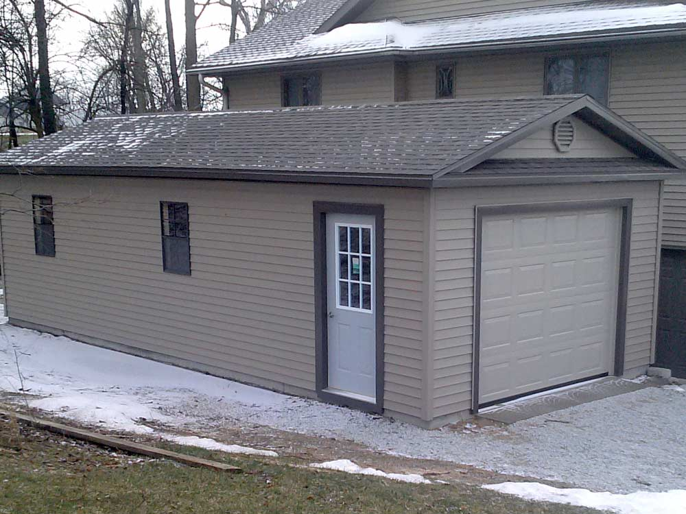 Mini Garage built to match the existing house by Martin's Mini Barns