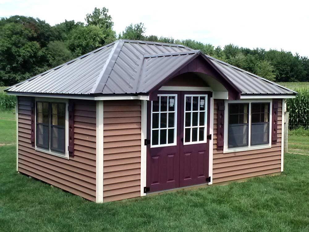 Tea house mini barn. Custom built playhouse for back yard storage and play by Martin's Mini Barns