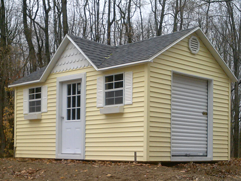 Doll House custom shed with vinyl siding roll top door